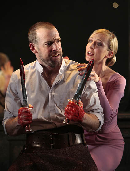 Ian Merrill Peakes (Macbeth) and Kate Eastwood Norris (Lady Macbeth), Macbeth, conceived and directed by Teller and Aaron Posner, Folger Theatre in a co-production with Two River Theater Company, 2008. T. Charles Erickson.