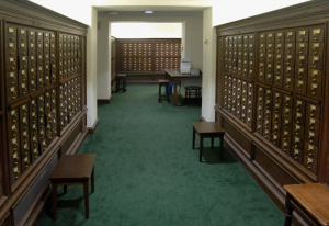 Room of wooden cabinets with hundreds of card file drawers.